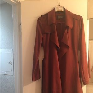 Maroon double breasted, belted trench coat
